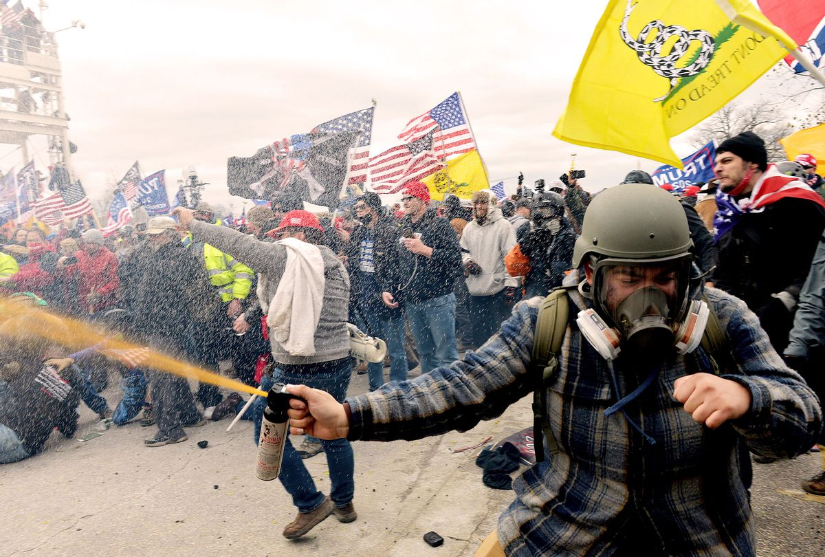 Trump supporters clash with police and security forces as people try to storm the US Capitol Building in Washington, DC, on January 6, 2021. - Demonstrators breeched security and entered the Capitol as Congress debated the a 2020 presidential election Electoral Vote Certification. (JOSEPH PREZIOSO/AFP via Getty Images)