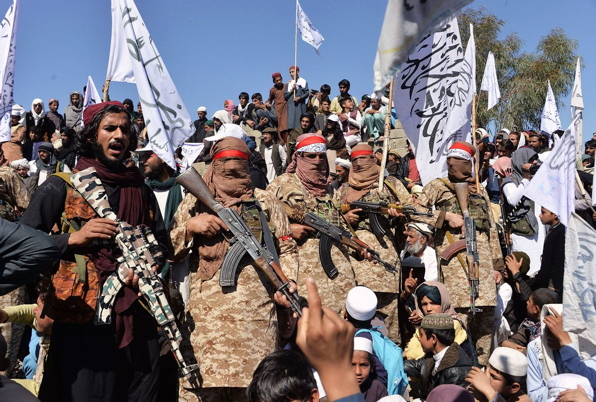 Afghan Taliban militants and villagers attend a gathering as they celebrate the peace deal and their victory in the Afghan conflict on US in Afghanistan, in Alingar district of Laghman Province on March 2, 2020. - The Taliban said on March 2 they were resuming offensive operations against Afghan security forces, ending the partial truce that preceded the signing of a deal between the insurgents and Washington. (NOORULLAH SHIRZADA/AFP via Getty Images)