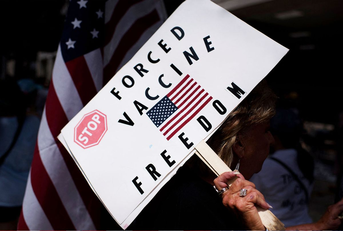 Anti-vaccine rally protesters hold signs outside of Houston Methodist Hospital in Houston, Texas, on June 26, 2021. (MARK FELIX/AFP /AFP via Getty Images)