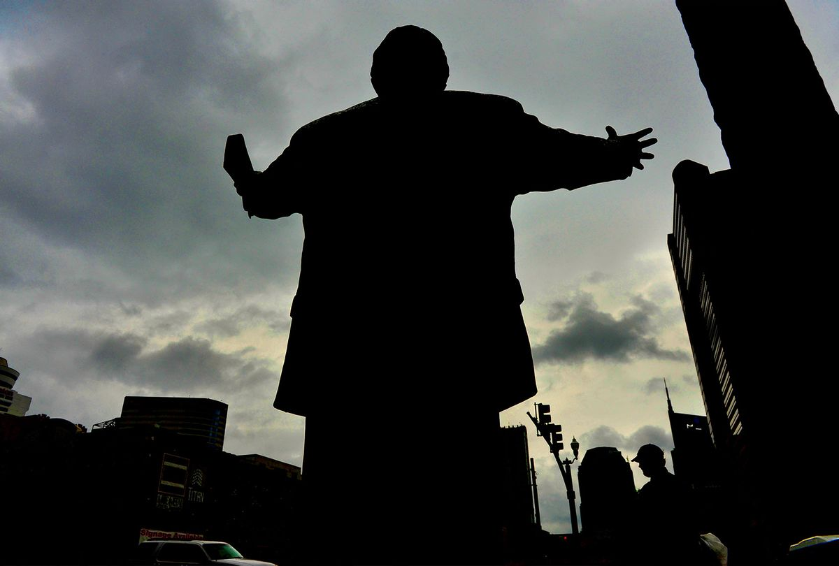 A 7-foot tall statue (with a 17-foot tall cross) of evangelist Billy Graham graces the front entrance to the headquarters of the Southern Baptist Convention in Nashville (Michael S. Williamson/The Washington Post via Getty Images)