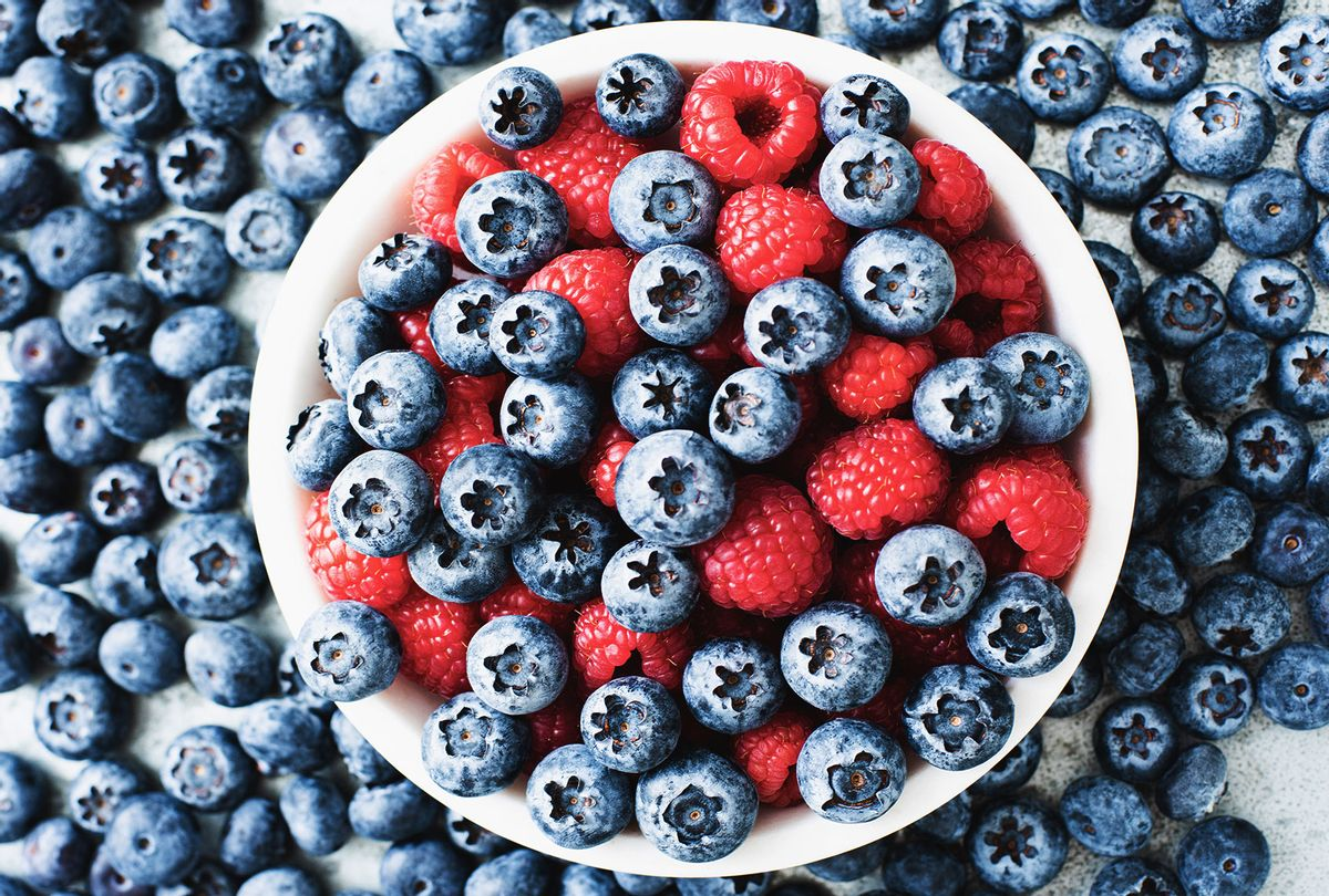 Bowl of blueberries and raspberries (Getty Images/Magdalena Niemczyk)