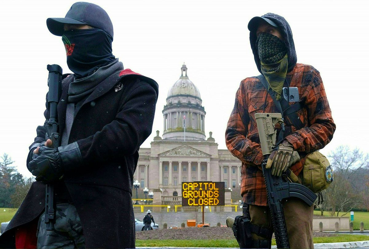 Members of the Boogaloo movement hold their rifles in front of the state capitol building in Frankfort, Kentucky, on January 17, 2021, during a nationwide protest called by anti-government and far-right groups supporting US President Donald Trump and his claim of electoral fraud in the November 3 presidential election. - The FBI warned authorities in all 50 states to prepare for armed protests at state capitals in the days leading up to the January 20 presidential inauguration of President-elect Joe Biden. (JEFF DEAN/AFP via Getty Images)