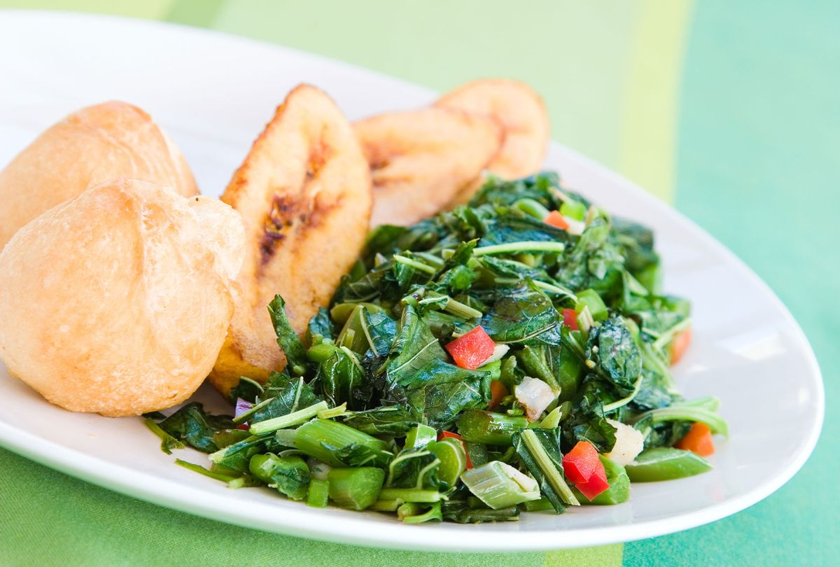 Speciality caribbean dish of callaloo (spinach) served with fried dumplings (Getty Images)