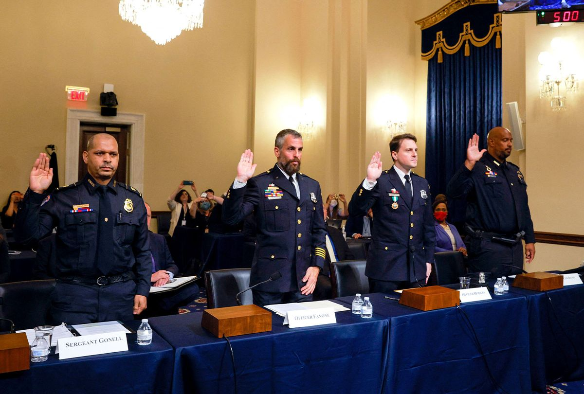 US Capitol Police Sergeant Aquilino Gonell, DC Metropolitan Police Department Officer Michael Fanone, DC Metropolitan Police Department Officer Daniel Hodges and US Capitol Police Private First Class Harry Dunn, are sworn in before members of the Select Committee, as they investigate the January 6, 2021, attack on the US Capitol, during their first hearing on Capitol Hill in Washington, DC, on July 27, 2021. - The committee will hear testimony from members of the US Capitol Police and the Metropolitan Police Department who tried to protect the Capitol against insurrectionists on January 6, 2021. (JIM BOURG/POOL/AFP via Getty Images)