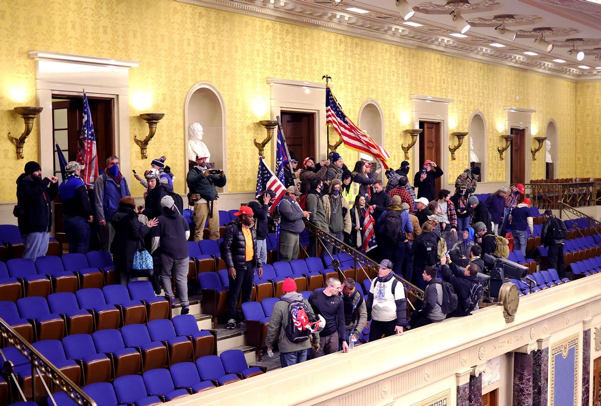 Protesters enter the Senate Chamber on January 06, 2021 in Washington, DC. Congress held a joint session today to ratify President-elect Joe Biden's 306-232 Electoral College win over President Donald Trump. Pro-Trump protesters have entered the U.S. Capitol building after mass demonstrations in the nation's capital. (Win McNamee/Getty Images)