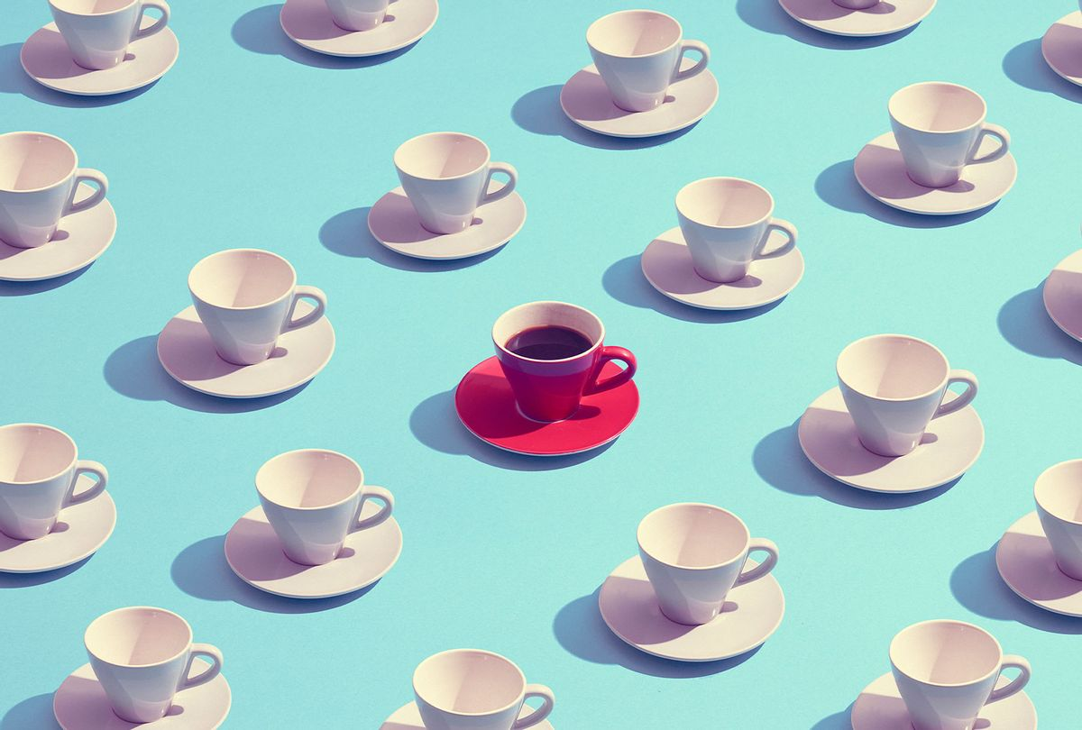 Large group of coffee cups placed in a pattern with one red cup standing out (Getty Images/Daniel Grizelj)