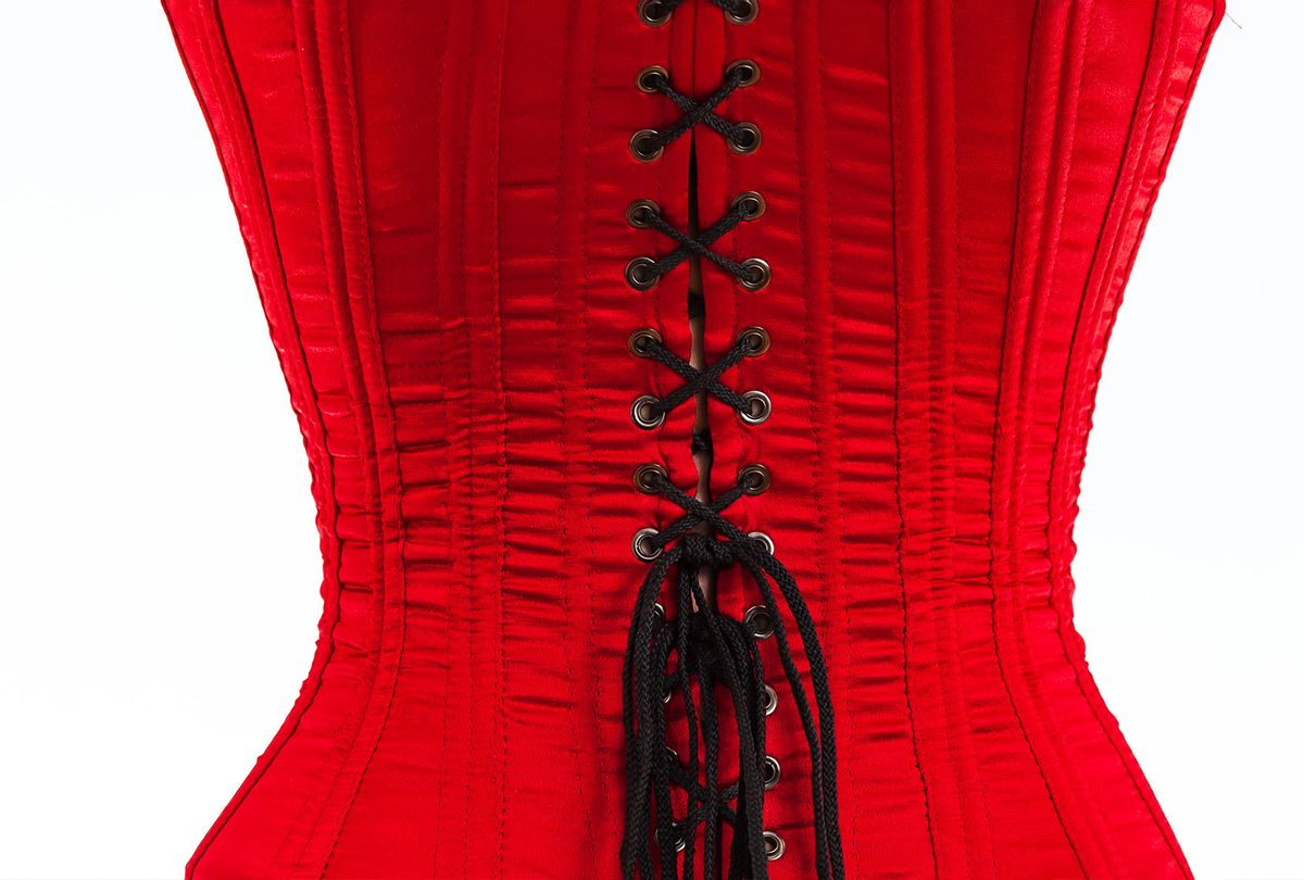 The back of a red corset with black laces (Getty Images)