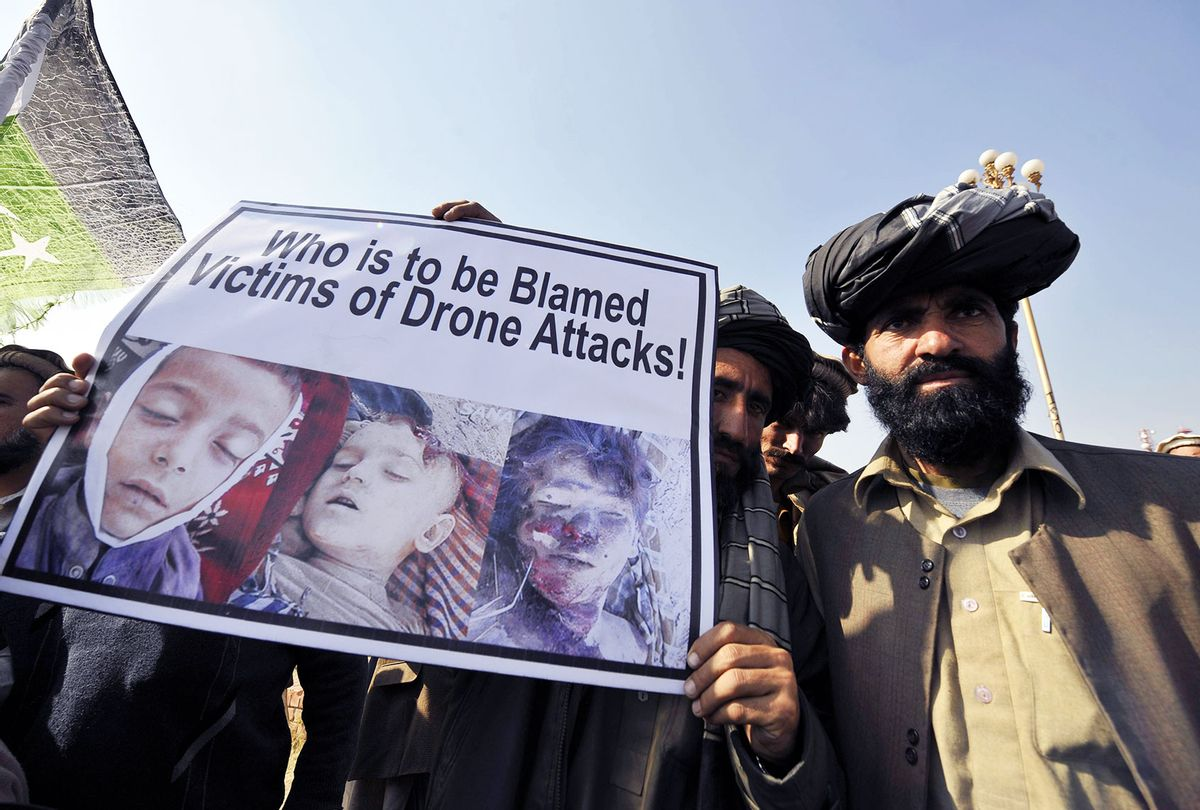 Pakistani tribesmen hold up a placard of alleged drone strike victims during a protest in Islamabad on February 25, 2012, against the US drone attacks in the Pakistani tribal region. The protesters demanded an immediate end to drone attacks and compensation for those who lost relatives or property, as well as condemning this week's burning of Korans at a US-run base in neighbouring Afghanistan. (AAMIR QURESHI/AFP via Getty Images)