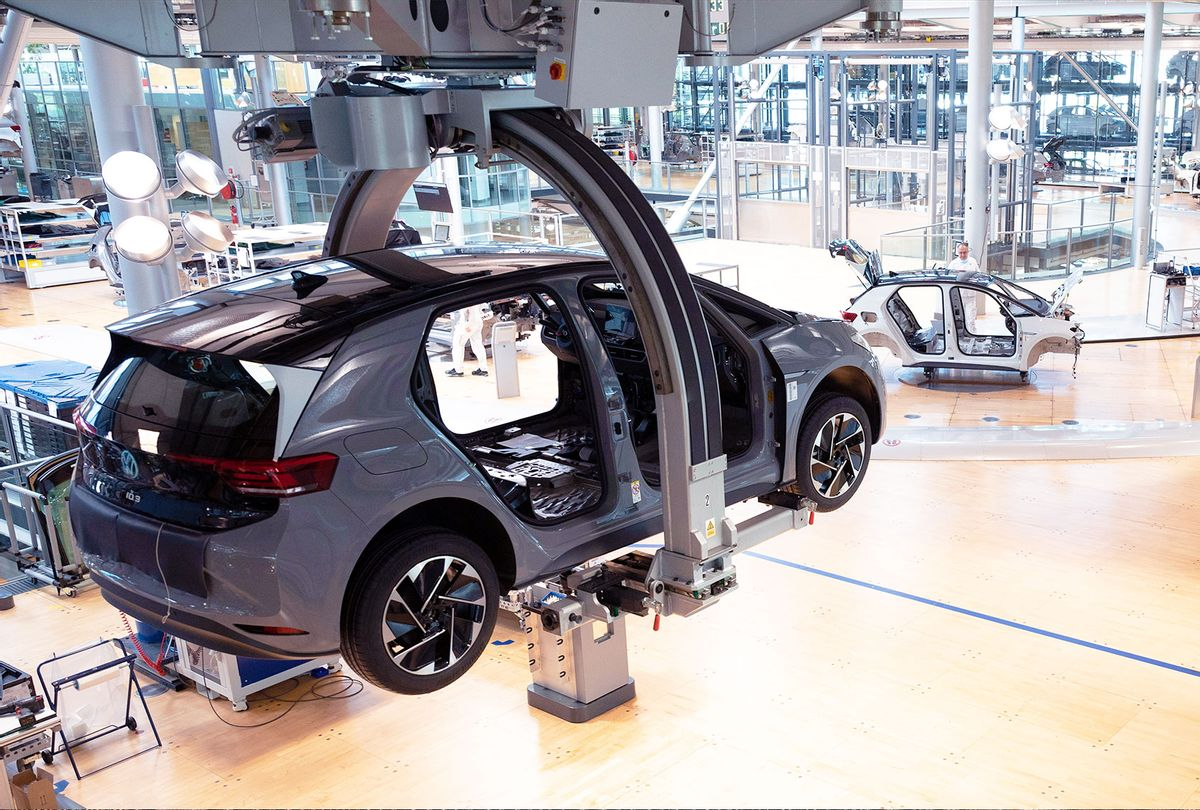 The body of a VW ID.3 hangs on a production line during a press tour of Volkswagen's Transparent Factory. At the site in Dresden, 35 fully electric vehicles are produced every day. (Effect due to long exposure) (Sebastian Kahnert/picture alliance via Getty Images)
