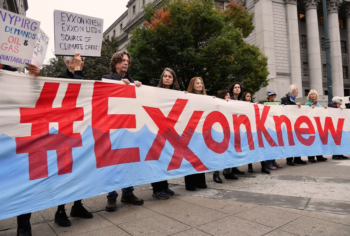 Climate activists protest on the first day of the Exxon Mobil trial outside the New York State Supreme Court building on October 22, 2019 in New York City. - Charges that Exxon Mobil misled investors on the financial risks of climate change will be heard in court after a New York judge gave the green light for a trial. (ANGELA WEISS/AFP via Getty Images)