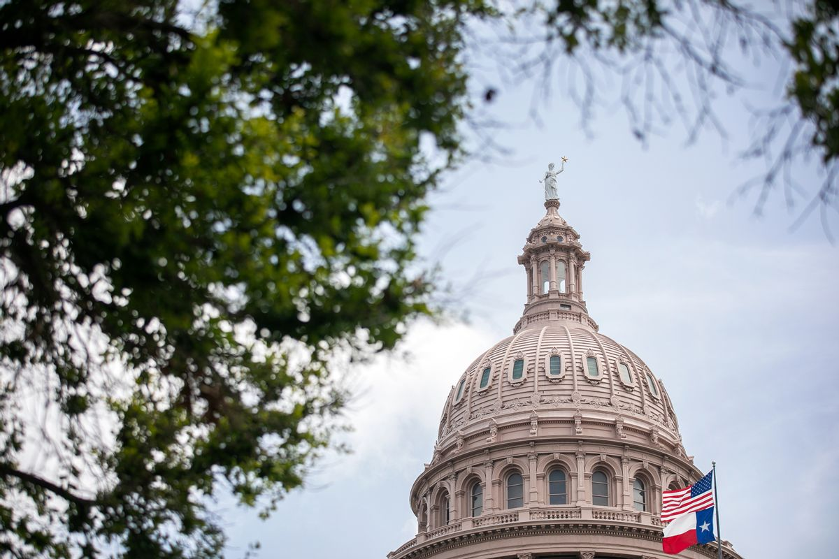 The U.S. and Texas flags wave outside the Texas Capitol on July 13, 2021 in Austin, Texas.  (Montinique Monroe/Getty Images)