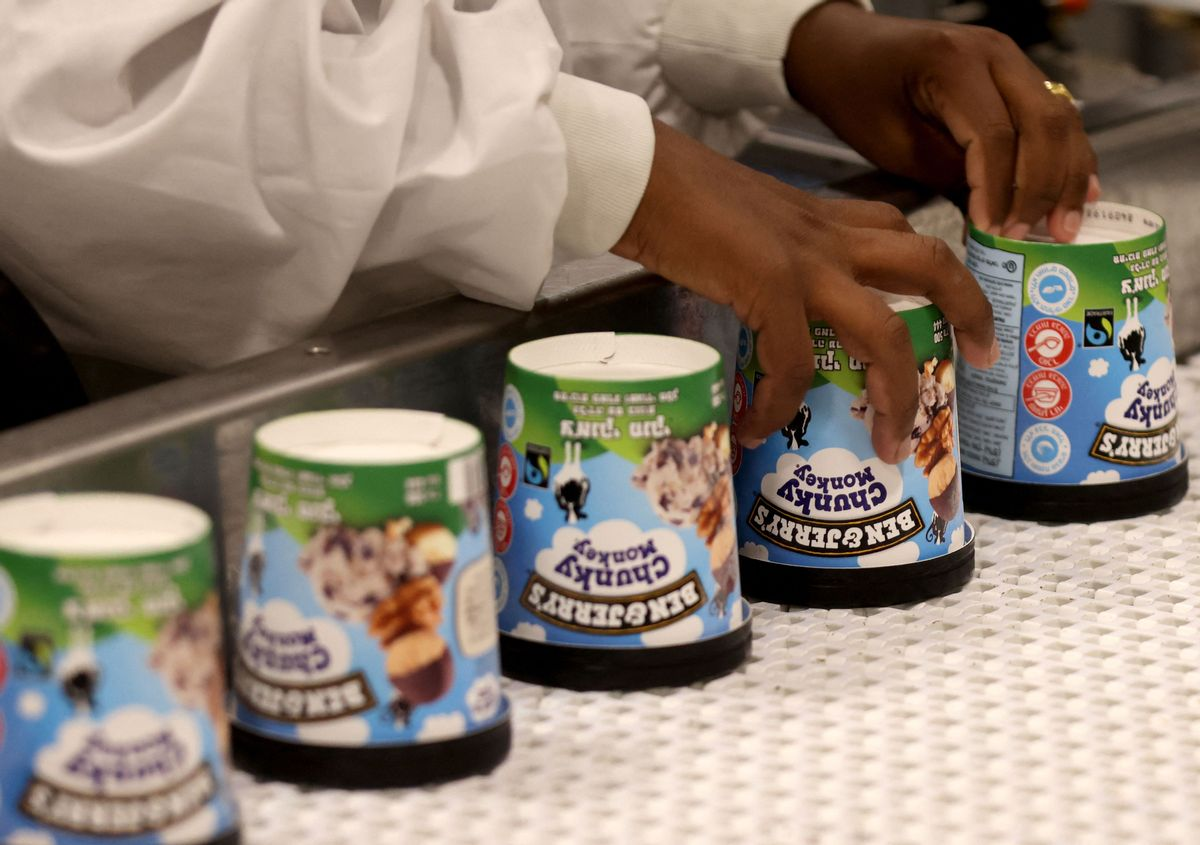 A labourer works on a production line filling ice-cream pots at the Ben & Jerry's factory in Be'er Tuvia in southern Israel, on July 21, 2021. (EMMANUEL DUNAND/AFP via Getty Images)