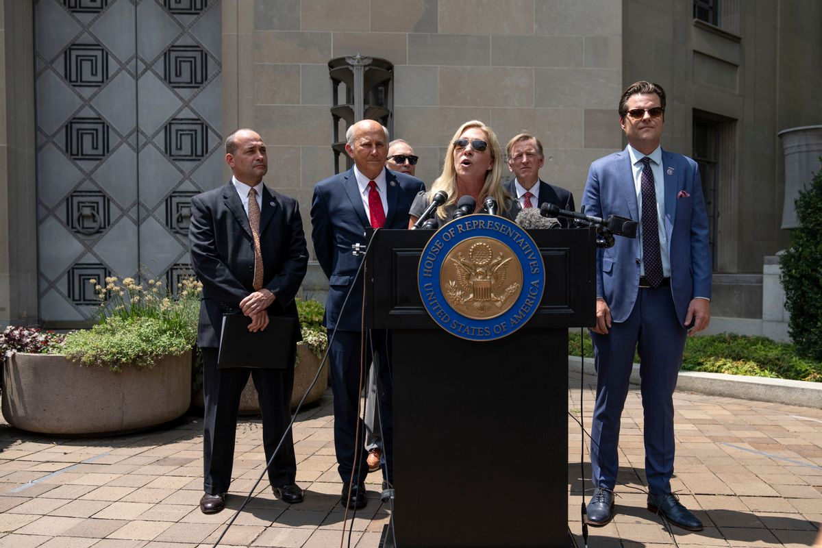 From left to right: Reps. Bob Good, Louie Gohmert, Andy Biggs, Marjorie Taylor Greene, Paul Gosar and Matt Gaetz hold a news conference outside the U.S. Department of Justice to demand answers from Attorney General Merrick Garland on the status of Jan. 6 prisoners.  (Getty Images)