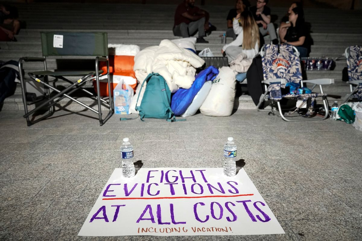 A sign calling for an extension to a federal eviction moratorium sits near Rep. Cori Bush (D-MO) as she spends the night outside the U.S. Capitol on July 31, 2021. (Getty Images)
