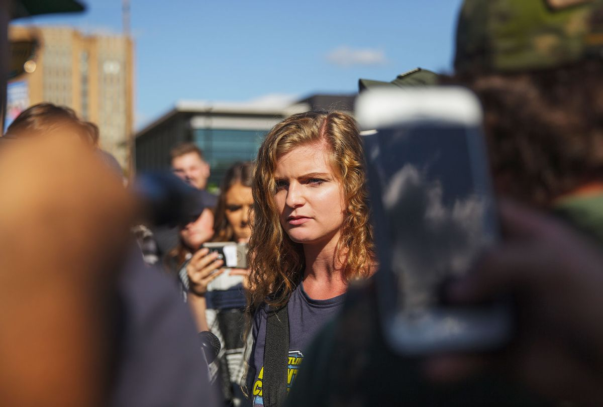 Kaitlin Bennett, a a squad of Three Precenter Milita members and a wall of police, tried to debate counter protesters. (Shay Horse/NurPhoto via Getty Images)