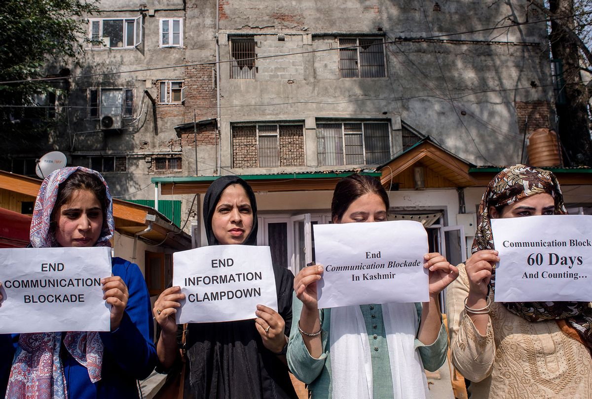 Kashmiri women journalists hold placards as they protest against the continued communication blockade by the Indian authorities after the revocation of special status of Kashmir on Oct. 3, 2019 in Srinagar. (Yawar Nazir/Getty Images)