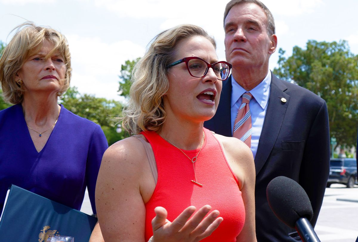 Sen. Kyrsten Sinema (D-AZ)speaking to members of the press as they arrive at the U.S. Capitol after a meeting with President Joe Biden at the White House on June 24, 2021 in Washington, DC. (Alex Wong/Getty Images)
