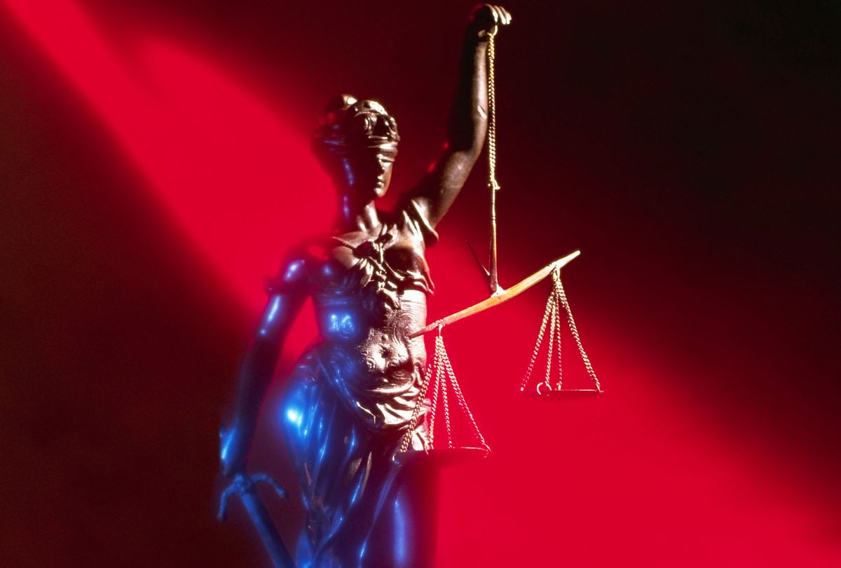 Lady Justice Holding Scales (Getty Images/Randy Faris)