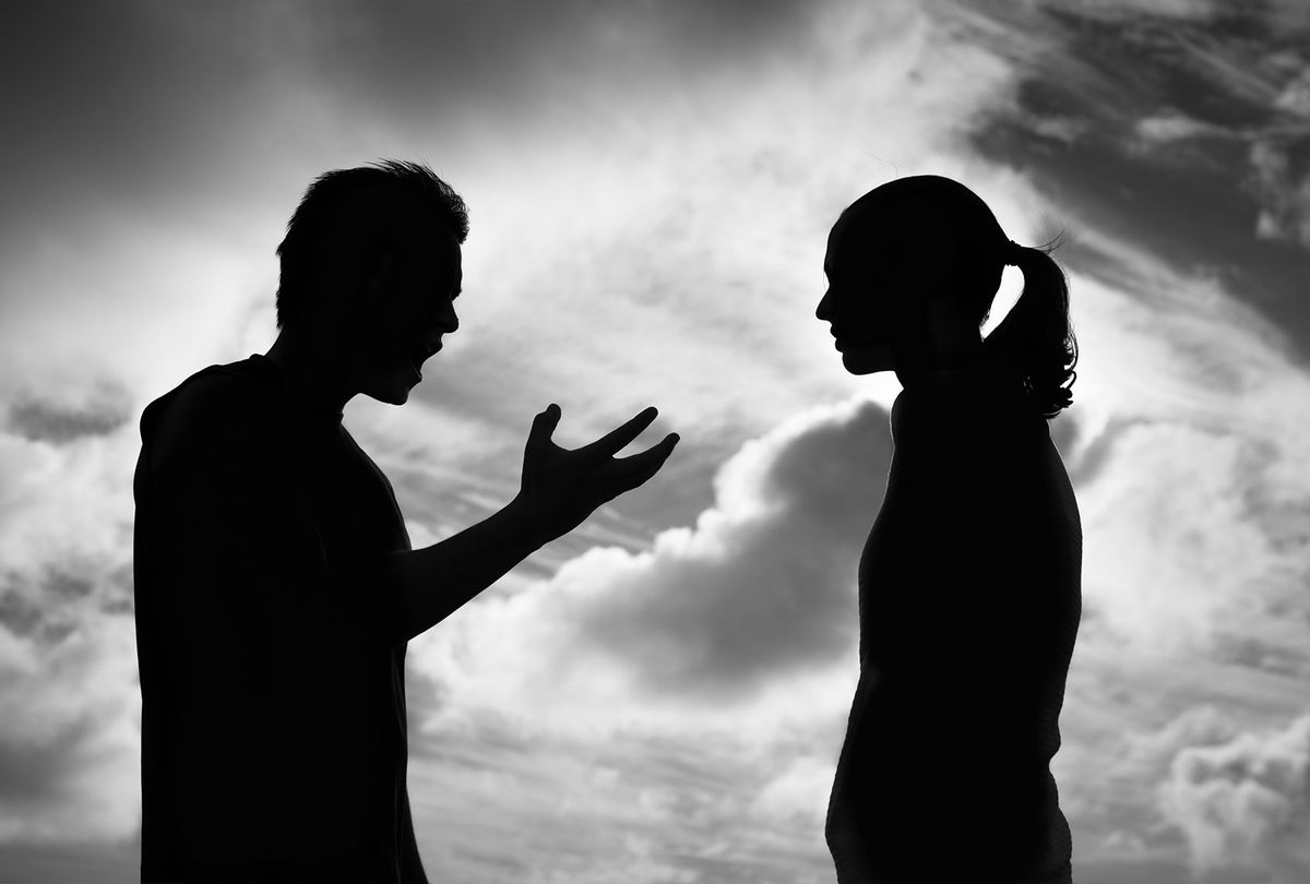 Silhouette of a man arguing with a woman (Getty Images)