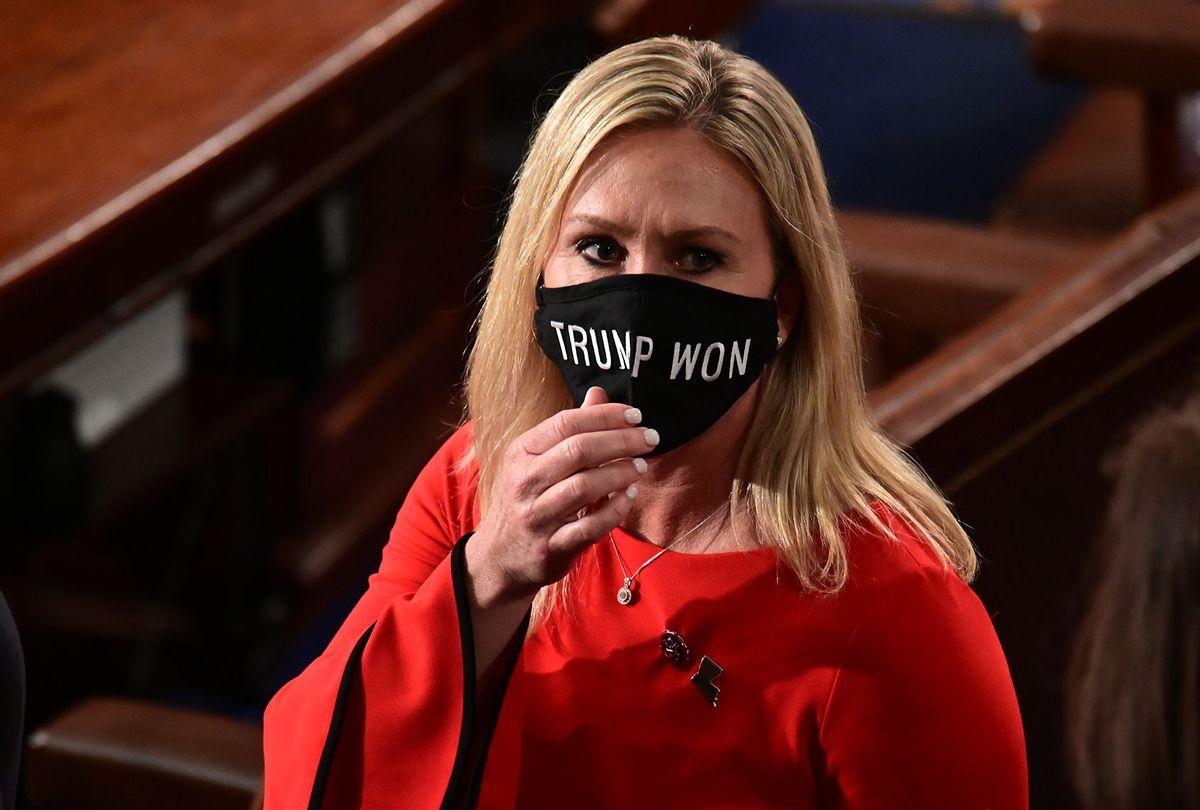 "U.S. Rep. Marjorie Taylor Greene (R-GA) wears a ""Trump Won"" face mask (Erin Scott-Pool/Getty Images)"