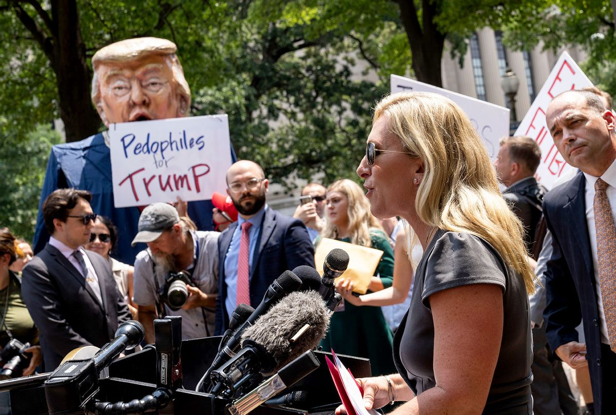 Protestors hold an effigy of former President Donald Trump as Rep. Marjorie Taylor Greene (R-GA) speaks during a news conference outside the U.S. Department of Justice on July 27, 2021 in Washington, DC. The group of far-right conservatives held a news conference to demand answers from Attorney General Merrick Garland on the status of January 6 prisoners. (Drew Angerer/Getty Images)