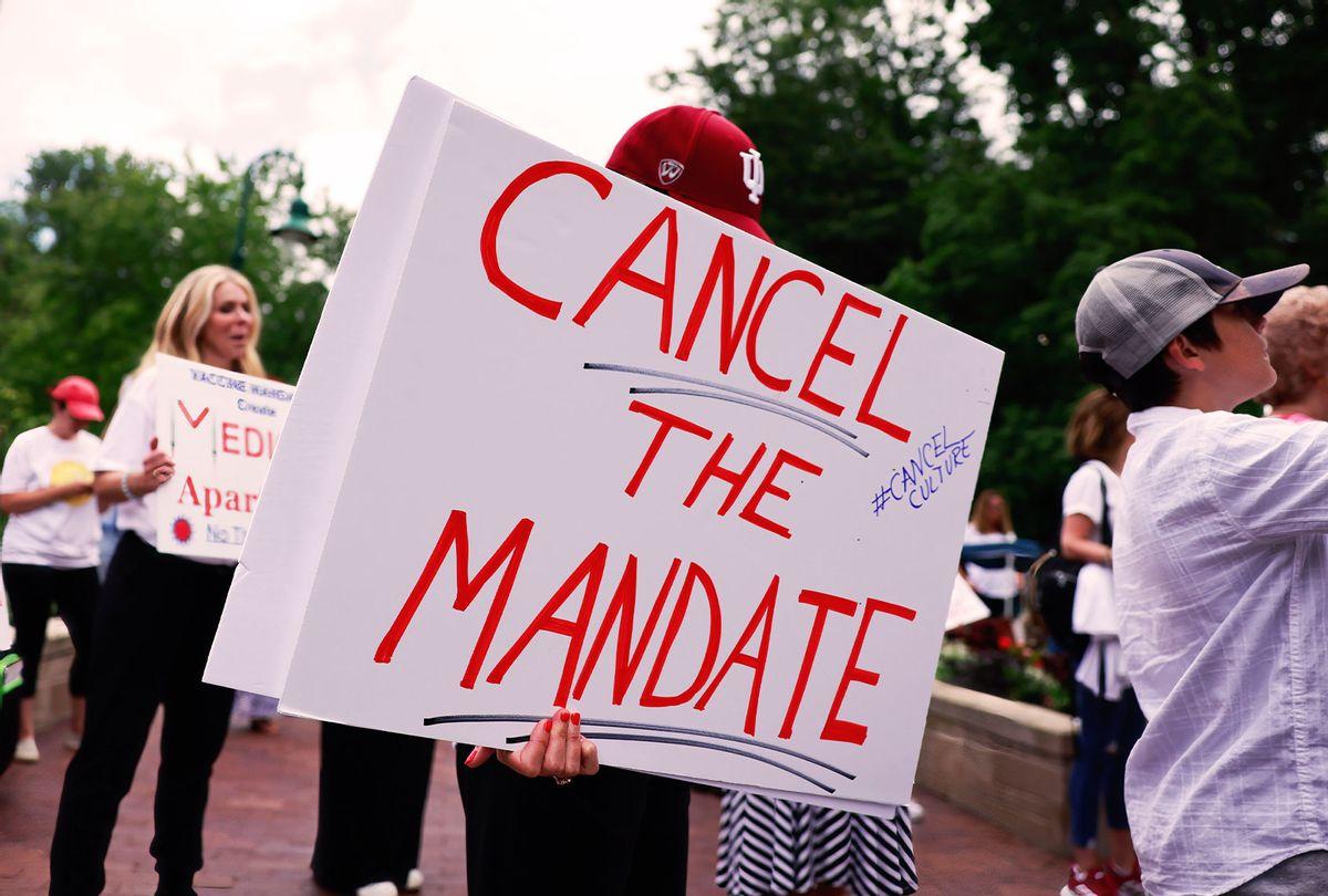 Anti-mask protesters holding placards during a demonstration. (Jeremy Hogan/SOPA Images/LightRocket via Getty Images)