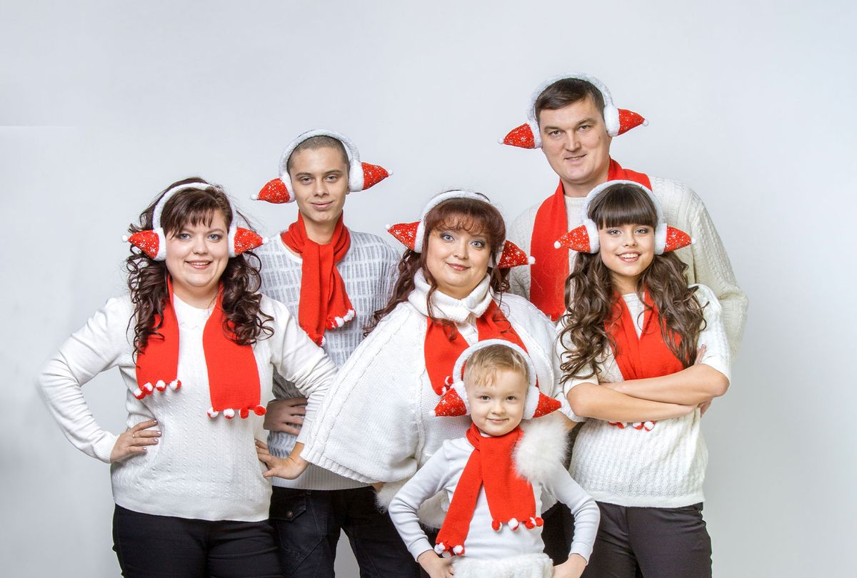 Family in matching Christmas outfits (Getty Images)