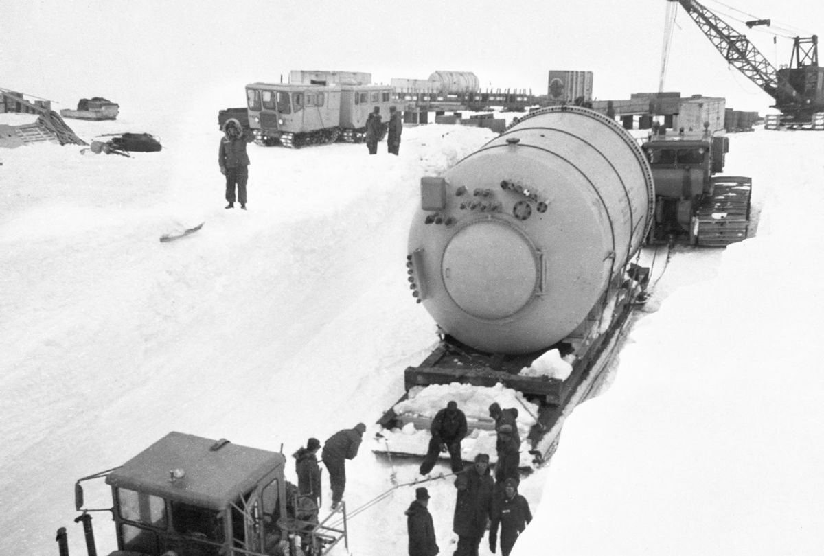 The U.S. Army Engineers who are installing a portable nuclear power plant shown as they move the vaper condenser, a component of plant, into the power plant, circa 1960. (Bettmann Archive/Getty Images)