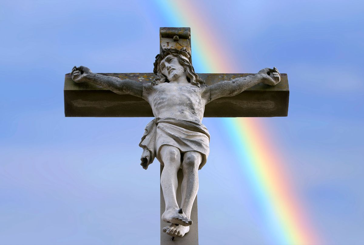 Rainbow behind a stone cross with Jesus (Getty Images/Werner Images)