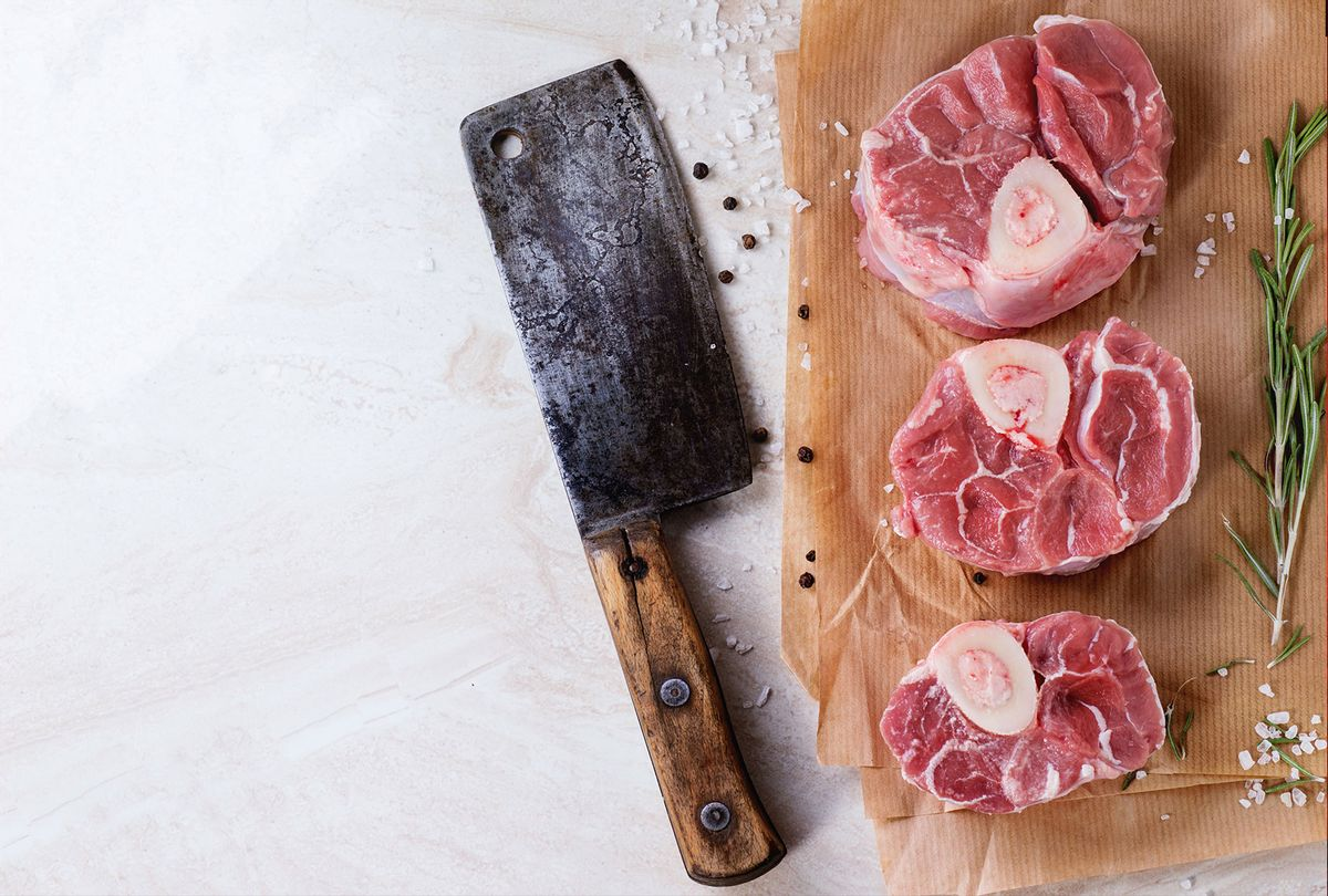 Raw osso buco meat on crumpled paper with salt, pepper and rosemary. (Natasha Breen/REDA&CO/Universal Images Group via Getty Images)