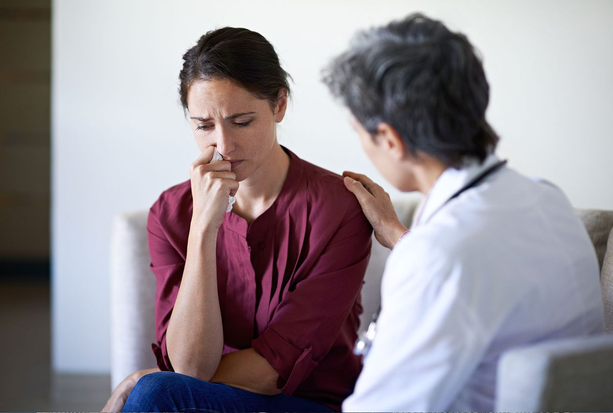 Doctor talking to distressed patient (Getty Images)
