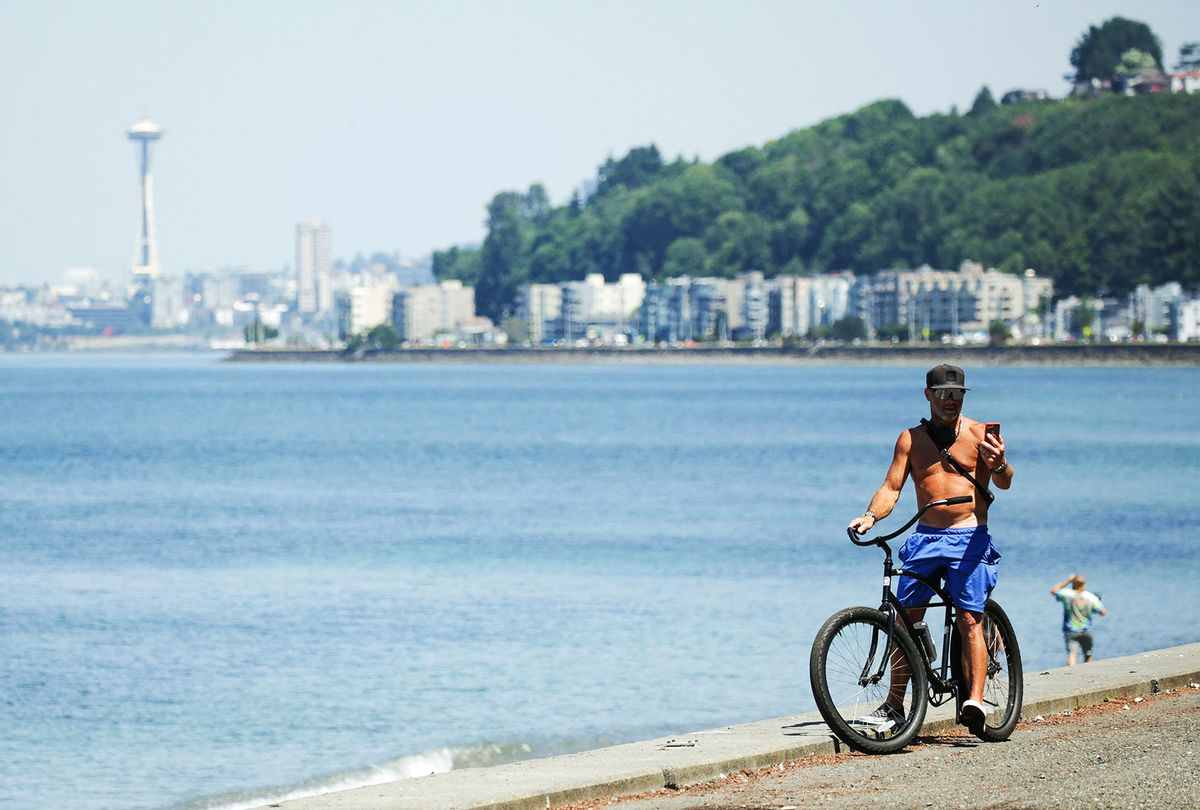 A bike rider is pictured as an excessive heat warning remains in effect a day after record-breaking temperatures from a historic heatwave throughout the region in Seattle, Washington on June 29, 2021. (JASON REDMOND/AFP via Getty Images)