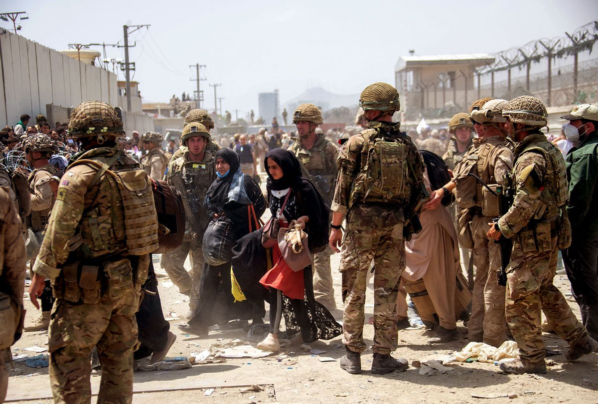 In this handout image provided by the Ministry of Defence, the British armed forces work with the U.S. military to evacuate eligible civilians and their families out of the country on August 21, 2021 in Kabul, Afghanistan. British armed forces have been evacuation UK citizens and eligible personnel out of the Afghan capital after the Taliban took control of the country last week. (MoD Crown Copyright via Getty Images)