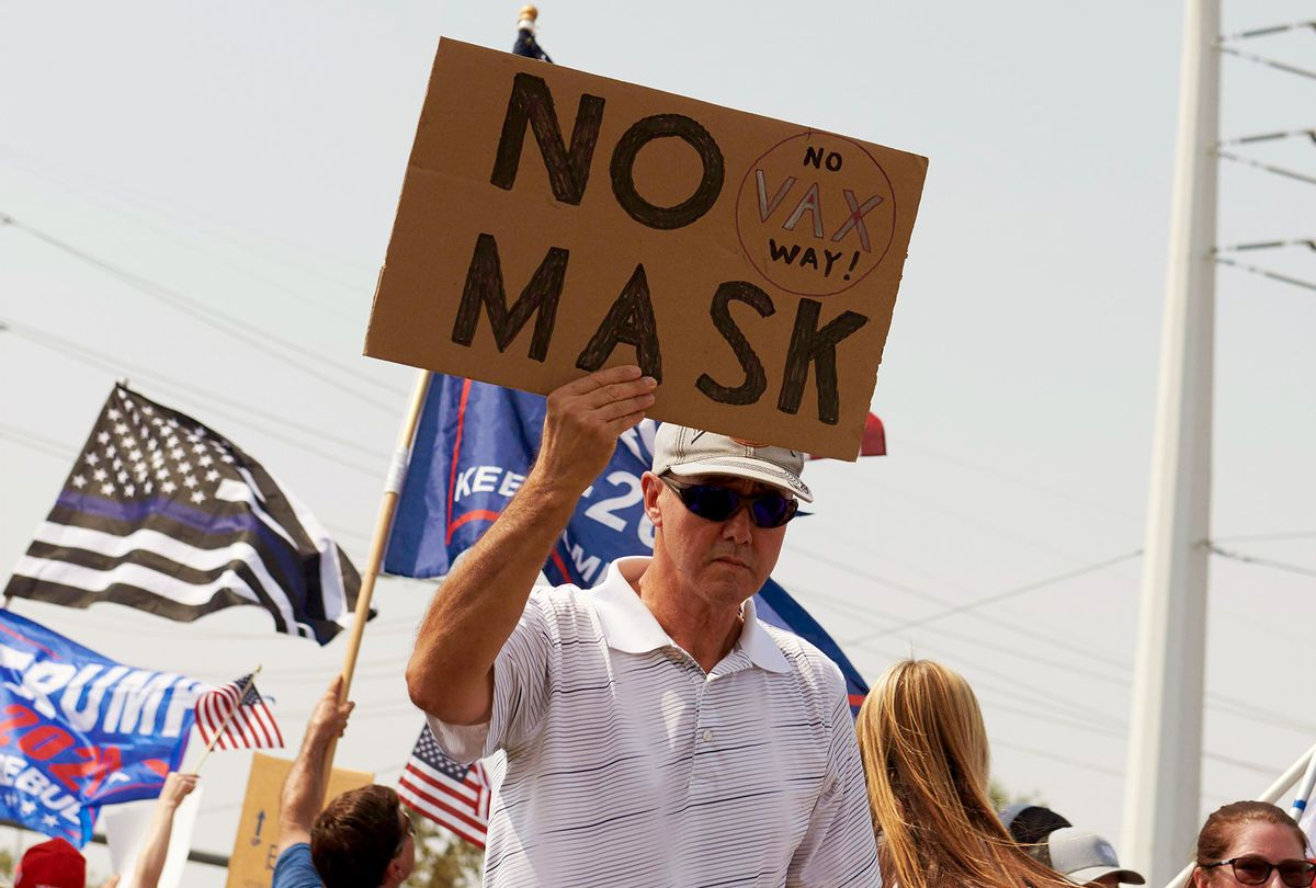 Protesters rally against a mask mandate, many showing support for US President Donald Trump, in Las Vegas, Nevada on August 22, 2020. (BRIDGET BENNETT/AFP via Getty Images)