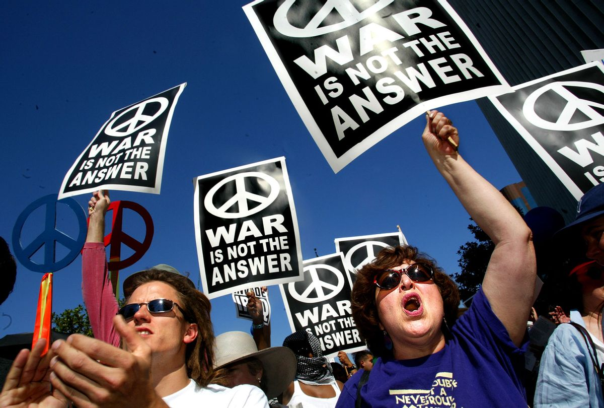 Anti-war protest at the Federal Building in Westwood on Sunday, October 6, 2002. Over 4,000 people gathered to voice their oppositon to a war against Iraq. (Carolyn Cole/Los Angeles Times via Getty Images)