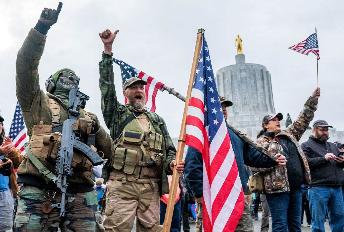Armed supporters of President Trump chant during a protest on January 6, 2021 in Salem, Oregon. Trump supporters gathered at state capitals across the country to protest today's ratification of Joe Biden's Electoral College victory over President Trump in the 2020 election. (Nathan Howard/Getty Images)
