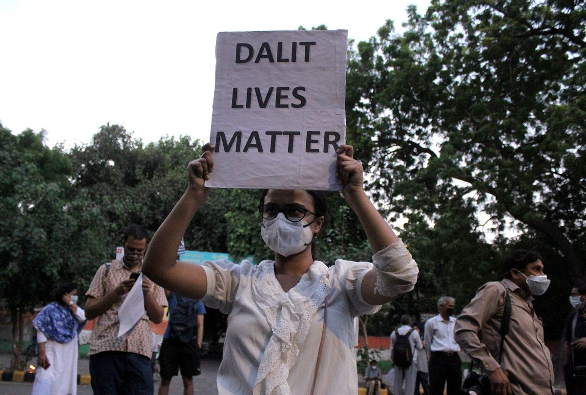 A student activist showing a placard stating 'Dalit Lives Matter' (Mayank Makhija/NurPhoto via Getty Images)
