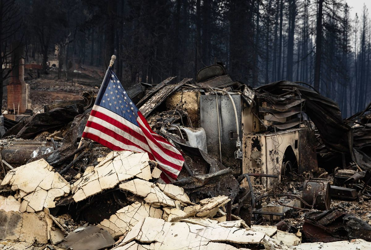 An American flag is placed amidst the rubble on August 8, 2021 in Greenville, California. The Dixie Fire, which has incinerated more than 463,000 acres, is the second largest recorded wildfire in state history and remains only 21 percent contained. (Maranie R. Staab/Getty Images)