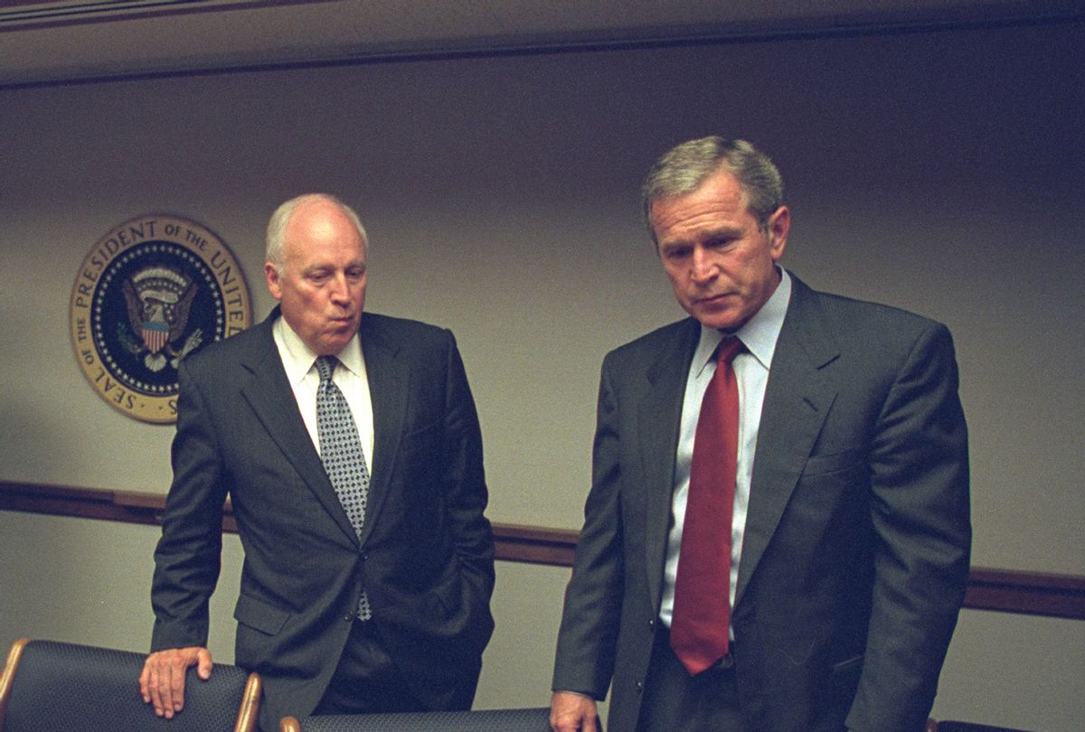 In this handout photo provided by the U.S. National Archives, Vice President Dick Cheney and President George W. Bush meet in the President's Emergency Operations Center (PEOC) after the terrorist attacks on September 11, 2001 in Washington, DC. (David Bohrer/U.S. National Archives via Getty Images)