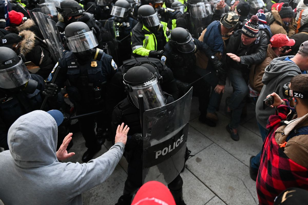 Riot police push back a crowd of supporters of US President Donald Trump after they stormed the Capitol building on January 6, 2021. (ROBERTO SCHMIDT/AFP via Getty Images)