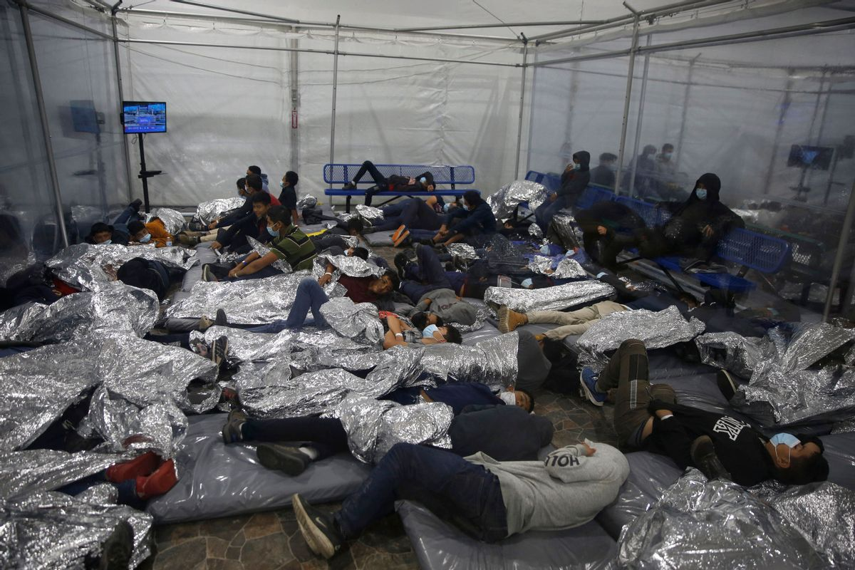 Young children rest inside a pod at the Donna Department of Homeland Security holding facility, the main detention center for unaccompanied children in the Rio Grande Valley. (DARIO LOPEZ-MILLS/POOL/AFP via Getty Images)