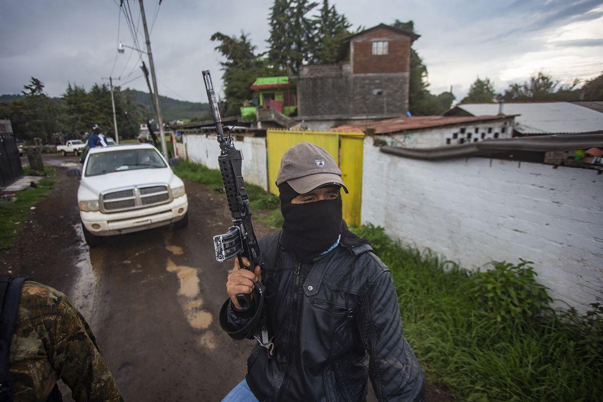 Members of the self-defense group Pueblos Unidos carry out guard duties in protection of avocado plantations in Ario de Rosales, Mexico. (Photo by ENRIQUE CASTRO/AFP via Getty Images)