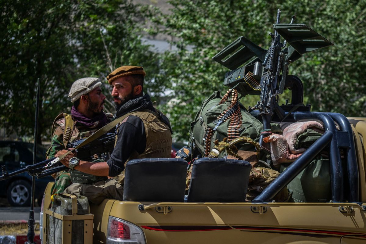 Soldiers from Afghan Security forces travel on a armed vehicle along a road in Panjshir province of Afghanistan on August 15, 2021.  (AHMAD SAHEL ARMAN/AFP via Getty Images)