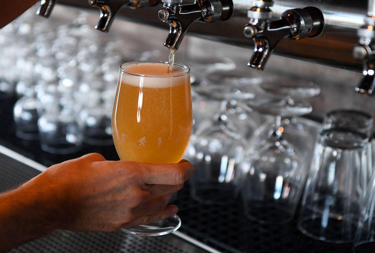 Jason Wilson pours a Great Divide Roadie Grapefruit Radler beer at the Great Divide Barrel Bar April 6, 2017 in Denver, Colorado. (Andy Cross/The Denver Post via Getty Images)