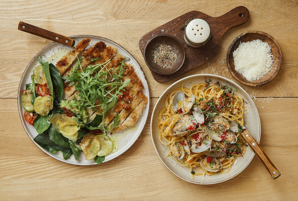 Crispy chicken Milanese. Spinach, grilled zucchini and walnut salad with potato chips. Pasta with vongole and tobiko caviar. (Getty Images)