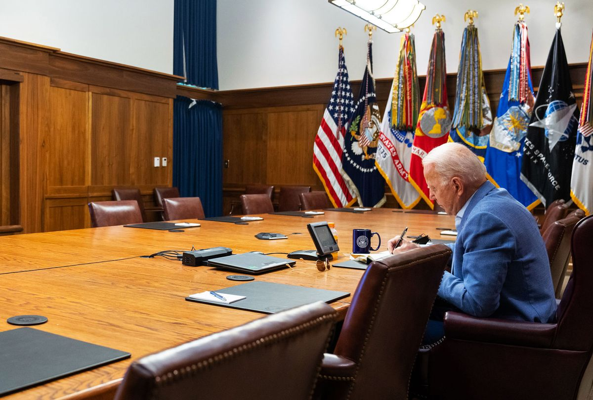 In this White House handout, U.S. President Joe Biden and Vice President Kamala Harris (off-camera) hold a video conference with the national security team to discuss the ongoing efforts to draw down our civilian footprint in Afghanistan August 16, 2021 at Camp David in Frederick County, Maryland. In addition, the President and Vice President were briefed on the earthquake in Haiti. (White House via Getty Images)