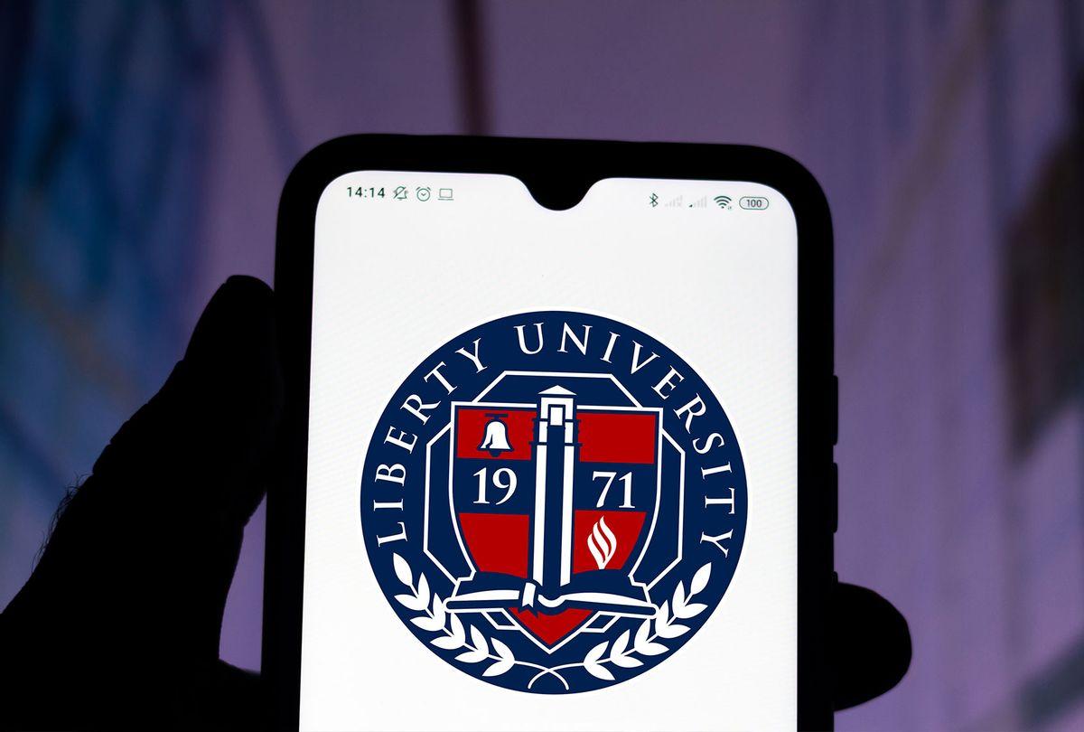 Liberty University logo seen displayed on a smartphone. (Photo Illustration by Rafael Henrique/SOPA Images/LightRocket via Getty Images)