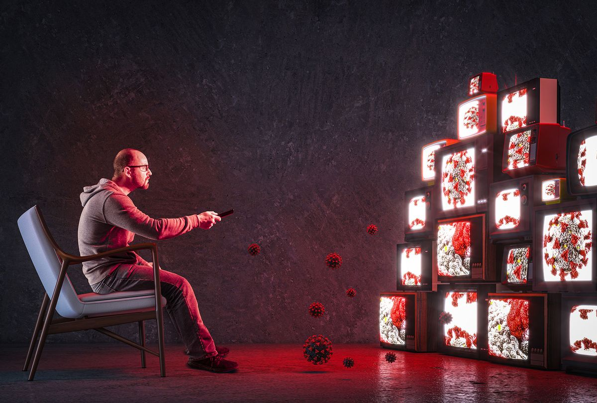 Man on an armchair watching many televisions that only broadcast news about COVID-19 (Getty Images/Tiero)