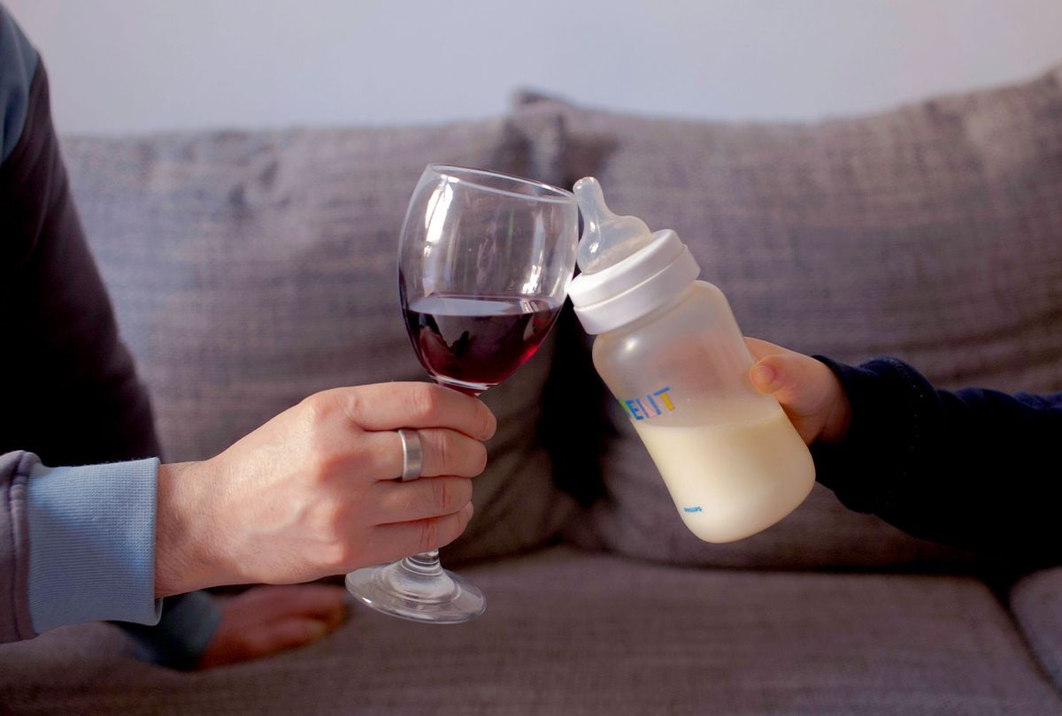Father And Son Toasting Wineglass And Milk Bottle (Getty Images/Monica Monti/EyeEm)