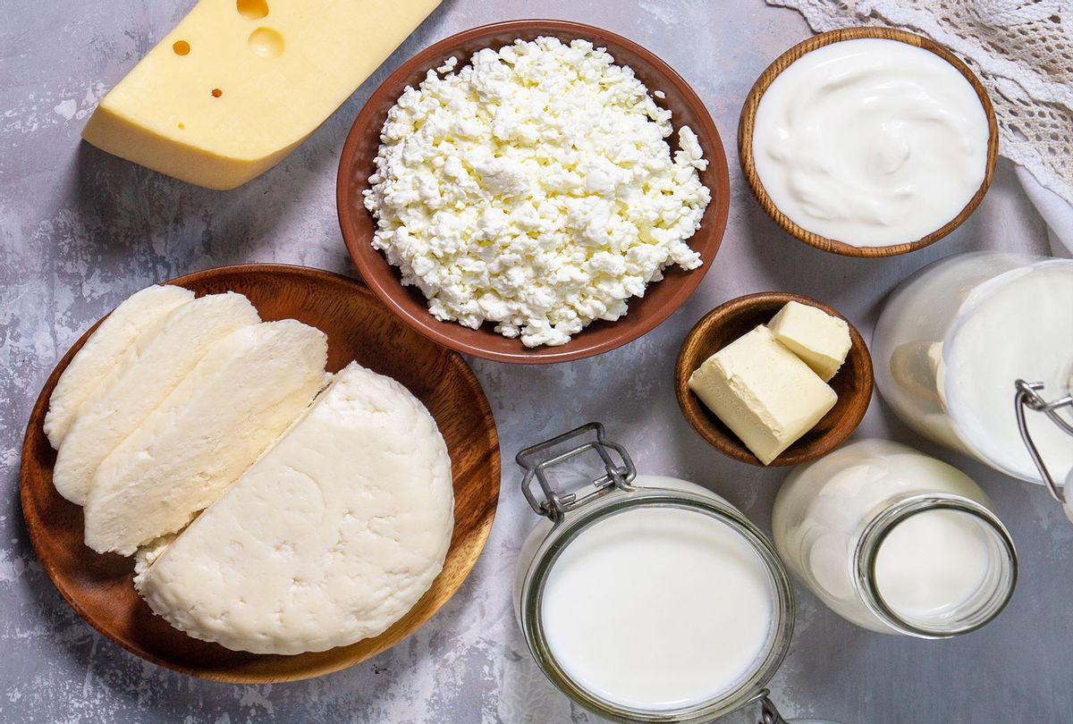 Various fresh dairy products, milk, sour cream, cottage cheese, yogurt and butter on a light stone countertop (Getty Images/Elena Hramowa)